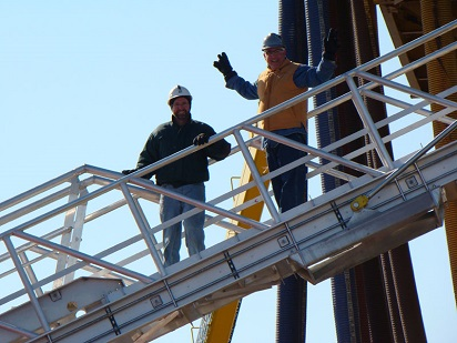 two workers staning on a custom marine access gangway